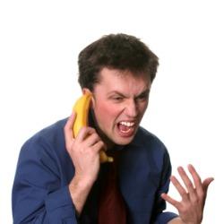 man talking into banana phone