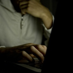 Man on computer. Image courtesy of Shutterstock.