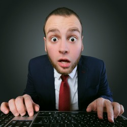 Shocked man. Image courtesy of Shutterstock