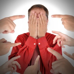 Embarrassed man. Image courtesy of Shutterstock.