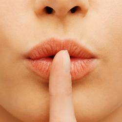 Finger on lips. Image courtesy of Shutterstock