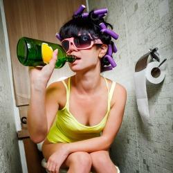 Girl on toilet. Image courtesy of Shutterstock.