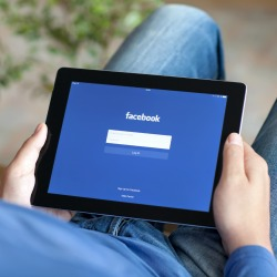 Man on Facebook. Image courtesy of Denys Prykhodov/Shutterstock